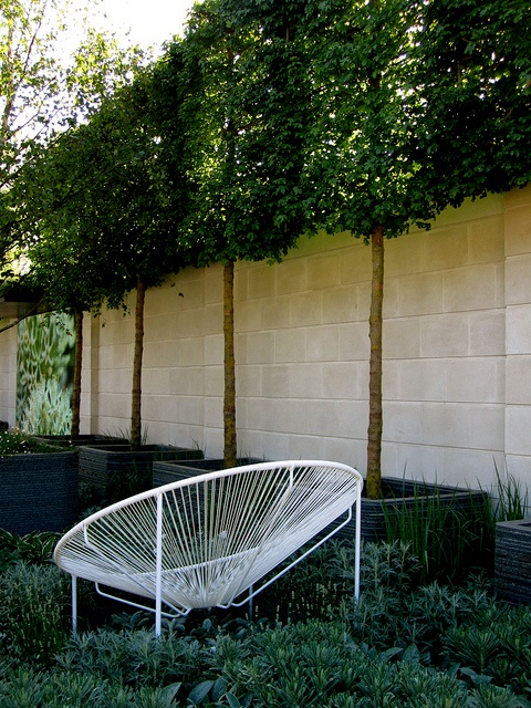 comfortable seating, shade and privacy make for a great outdoor workspace