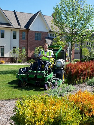 Riding mowers can cover ground faster than a person can push a walk-behind mower