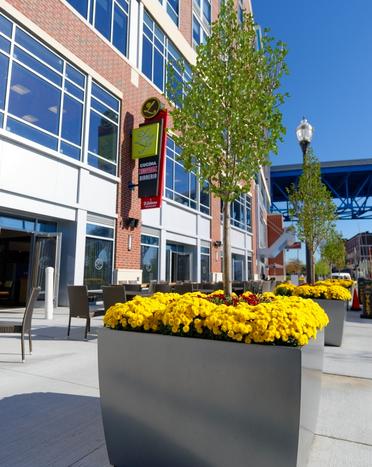 outdoor planters help properties change their look each season