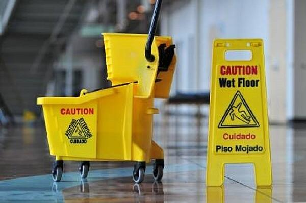 mop-bucket-and-caution-sign