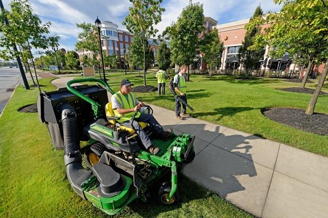 Schill employee mowing lawn
